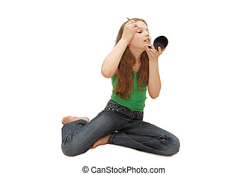 The young girl imposes a make-up isolated - The young girl...