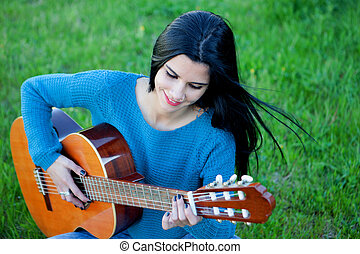 Pretty guitarist playing the guitar