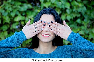 Brunette girl covering her eyes