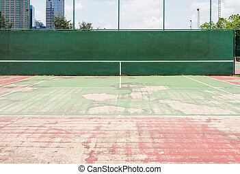 Half tennis court in the sport complex of urban park