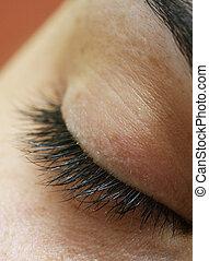 Closed eye - Macro shot of a beautiful woman\'s eye.