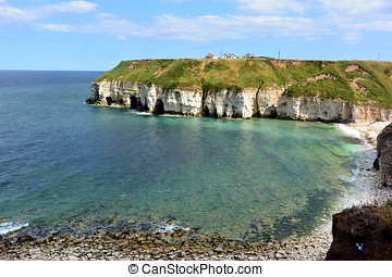 Thornwick Bay UK - Clear water as the tide comes in and...