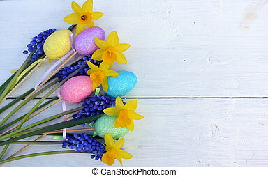 Easter Flowers - Spring flowers on a distressed white wood...