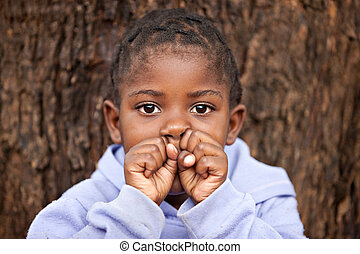 african child - shallow DOF of african child , bark of tree...
