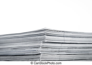 Magazines up close shot on white background - Mono magazines...