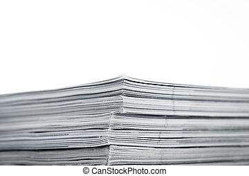 Magazines up close shot on white background - Mono magazines...