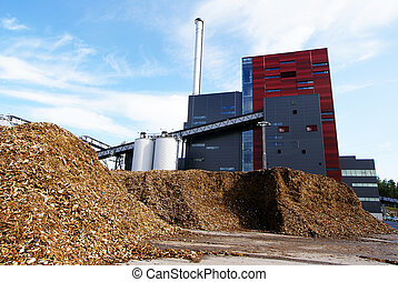 bio power plant with storage of wooden fuel biomass against...
