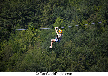 Adult woman on zip line
