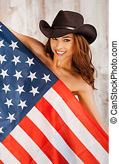 Americasn beauty Beautiful young shirtless cowgirl wearing...