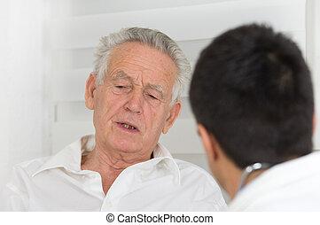 Senior man with doctor - Senior man talking about symptoms...