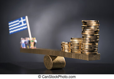 Money for Greece - Seesaw with coins