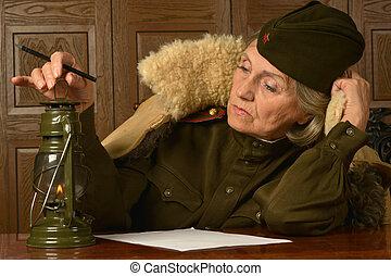 woman in uniform - elderly woman in uniform writing a letter