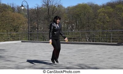 beautiful woman jumping rope - young beautiful woman in...