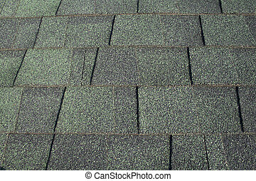 Green Asphalt Shingles - A background consisting of green...