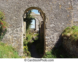 Stone Archway - A view through many stone archways.