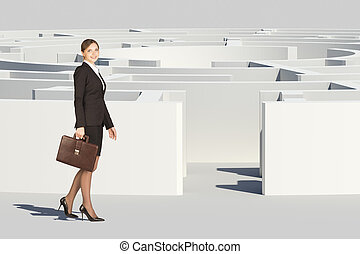 Businesswoman with suitcase looking at camera, entering...