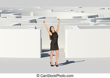 Businesswoman with hands up looking at camera, near...