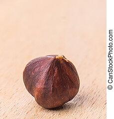 Hazelnut on wooden cutting board