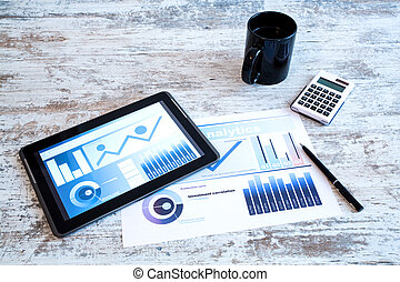 Business Analytics on a wooden Desk with a Tablet PC.