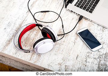 Headphones in the office - A modern home office setup on a...
