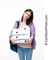 Unhappy young woman with backpack and folders - Portrait of...