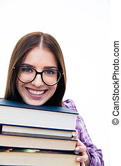 Smiling young female student with books
