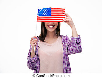 Smiling young student covering her eyes with flag