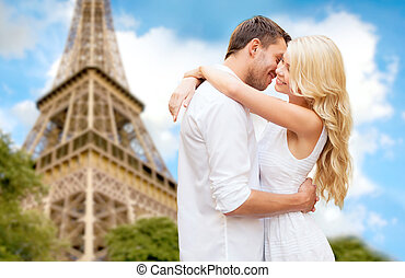 happy couple hugging over eiffel tower - travel, tourism,...
