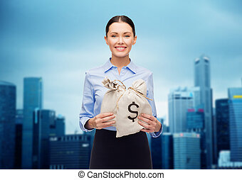 businesswoman holding money bags with euro - business,...