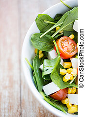 close up of vegetable salad bowl - healthy eating, dieting,...