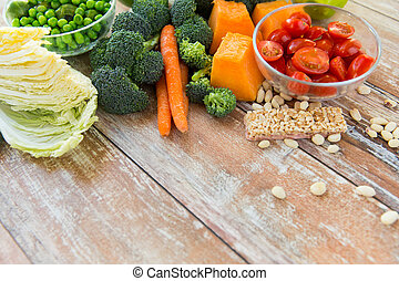 close up of ripe vegetables on wooden table - healthy...