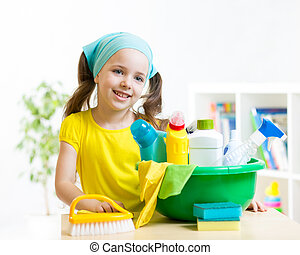 kid girl make cleaning in the children room at home