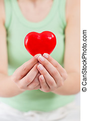 Health Care Love Support Red Heart in female hands