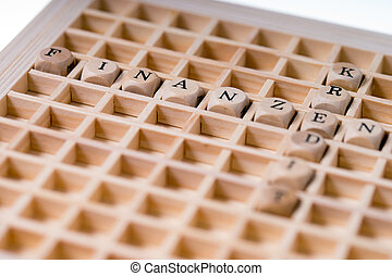 Finance and Credit - small wooden cubes with the german...