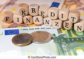 Finance and Credit - Euro money and wooden cubes with the...