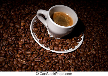 Coffee beans with a cup of espresso
