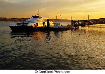 Sunset Ferryboat - Ferryboat docked ina pier in Lisbon at...