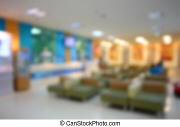 Blurred waiting chairs zone in hospital as background