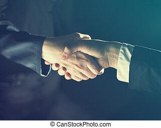 Handshake Handshaking and light - Handshake Handshaking dark...