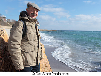 Senior man on the sea beach