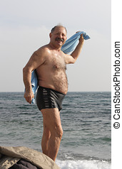Senior man after sea bathing