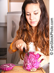 Young woman cutting red Cabbage - A young woman cutting red...