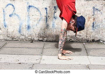 Vertical breakdance close-up - A performing hip-hop dancer...