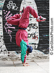 Vertical breakdance - A colorful performing hip-hop dancer...
