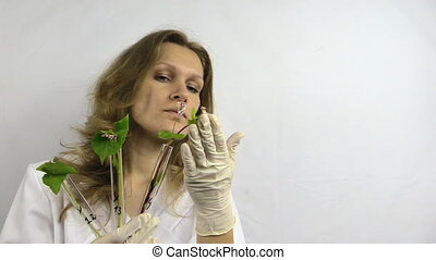 woman research plants - Scientist woman in white robe...