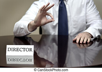 Director at Desk Sign with Hands Gesturing