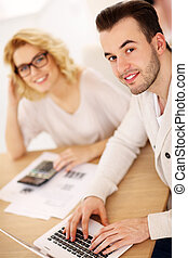 Young couple working on documents at home
