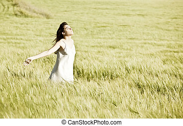Young girl in field - Young girl feeling freedom in field