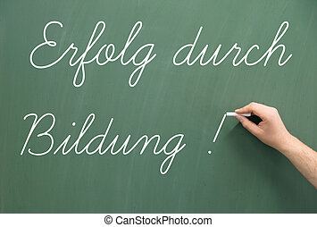 Education - Chalkboard with the german words Success through...