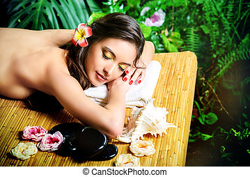 spa - Beautiful young woman getting spa treatments at a...